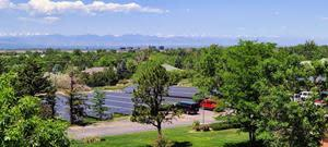 A view of the Oxford Vista solar field with a backdrop of the Colorado mountain range.
