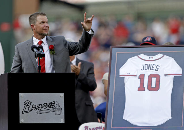 FILE - In this June 28, 2013, file photo, former Atlanta Braves' Chipper Jones waves to the crowd as he steps to the podium during a pregame ceremony retiring his number before a baseball game between the Atlanta Braves and the Arizona Diamondbacks, in Atlanta. All signs point to Jones being selected to the Baseball Hall of Fame when the next group of inductees is announced Wednesday, Jan. 24, 2018. (AP Photo/David Goldman, File)