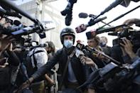 The personal physician for Diego Maradona, Leopoldo Luque, speaks to members of the media as he leaves the clinic where the former football star underwent brain surgery for a blood clot