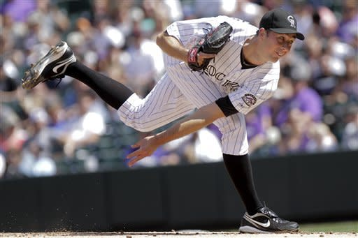 Colorado Rockies starting pitcher Jeff Francis, challenges San Diego Padres' Logan Forsythe, during the first inning of a baseball game Sunday, Sept. 2, 2012 in Denver. (AP Photo/Barry Gutierrez)