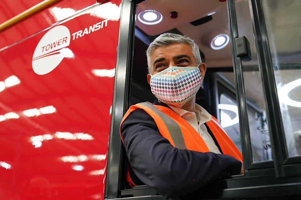 Son of a bus driver: Sadiq Khan at electric bus factory in Yorkshire (Getty Images)