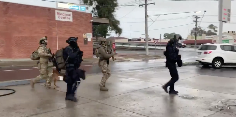 Streets in the area have been locked down as heavily armed police attend the scene. Source: Nine News