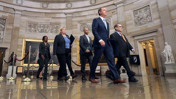 PHOTO: Representatives walk through the Rotunda of the Capitol on their way to the Senate, Jan. 16, 2020. (Chip Somodevilla/Getty Images)