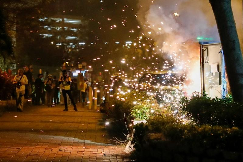 An electricity switch box explodes as it was set on fire by protesters, after Chow Tsz-lok, 22, a university student, died after he fell during a protest, at Tseung Kwan O, Hong Kong