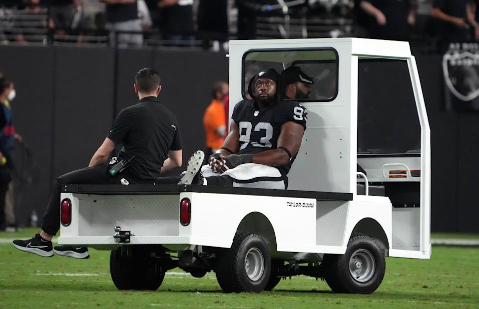 Las Vegas Raiders defensive tackle Gerald McCoy (93) is taken to the locker room after suffering an apparent injury against the Baltimore Ravens during the second half at Allegiant Stadium.