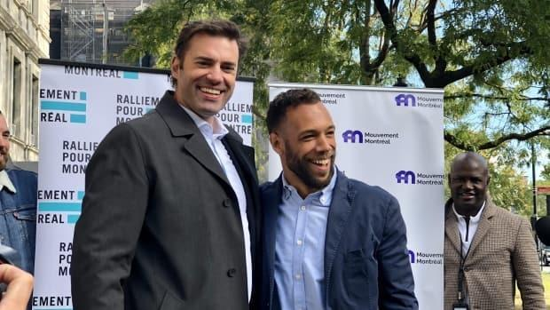 Balarama Holness, the leader of Mouvement Montréal, right, and Marc-Antoine Desjardins, the leader of Ralliement pour Montréal, left, announced plans to merge their parties during a news conference on Thursday. (Jérôme Labbé/Radio-Canada - image credit)