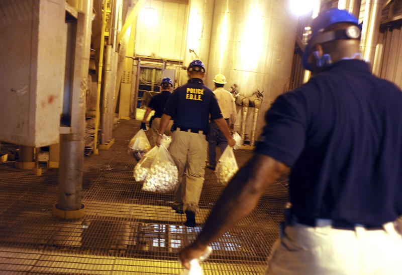 In this Aug. 15, 2011 photo, Florida Department of Law Enforcement officers carry bags of prescription drugs that were confiscated from a clinic to be burned in an incinerator facility in Coconut Creek, Fla.  Florida's 'pill mills' were a gateway to the nation's opioid crisis, feeding addiction and overdoses in Appalachia and other states. They exploded across Florida in the early 2000s and operated for years with little oversight. The release this week of July 19, 2019,  of a trove of federal data showing the distribution of opioids across the U.S. put the spotlight again on Florida's notorious 'pill mills,' which provided the seeds of an epidemic that continues to cost tens of thousands of lives each year. (Carey Wagner, South Florida Sun Sentinel via AP)