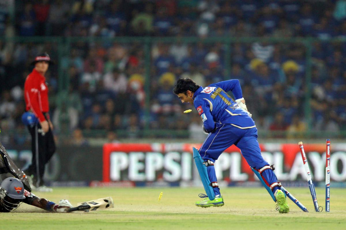Dinesh Yagnik removes the bails to run out Darren Sammy during the Eliminator match of the 2013 Pepsi Indian Premier League between the Rajasthan Royals and the Sunrisers Hyderabad held at the Feroz Shah Kotla Stadium, Delhi on the 22nd May 2013. (BCCI)