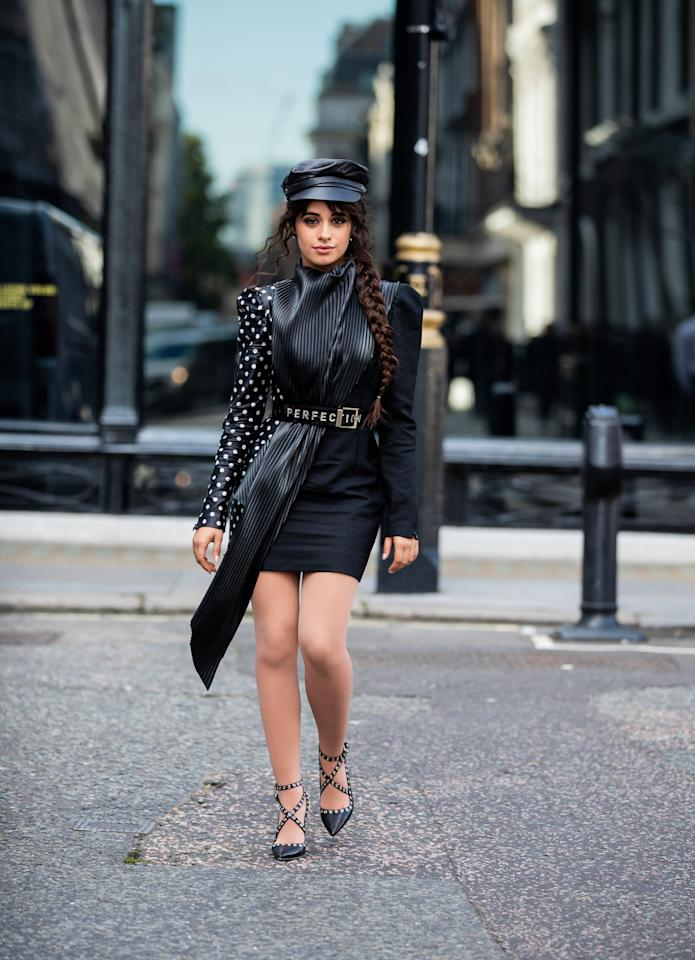 Proving polka dots are an always whimsical addition, especially when paired with a cap.