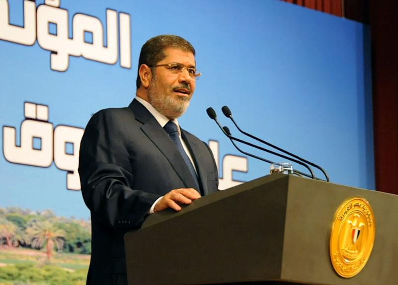 """In this Monday, June 10, 2013, photo released by the Egyptian Presidency, Egypt's President Mohammed Morsi speaks on Ethiopia's Nile dam project at a conference in Cairo. Morsi on Monday hardened his stance against Ethiopia and its construction of a Nile dam, warning that """"all options are open"""" in dealing with the project that threatens to leave Egypt with a dangerous water shortage. (AP Photo/Egyptian Presidency)"""