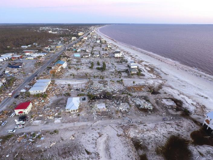 <p>Damaged homes are seen along the water's edge in the aftermath of hurricane Michael in Mexico Beach, Fla., Friday, Oct. 12, 2018. (Photo: David Goldman/AP) </p>