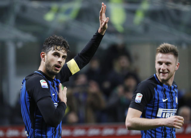 Inter Milan's Andrea Ranocchia, left, celebrates with his teammate Milan Skriniar after scoring during the Serie A soccer match between Inter Milan and Benevento at the San Siro stadium in Milan, Italy, Saturday, Feb. 24, 2018. (AP Photo/Antonio Calanni)