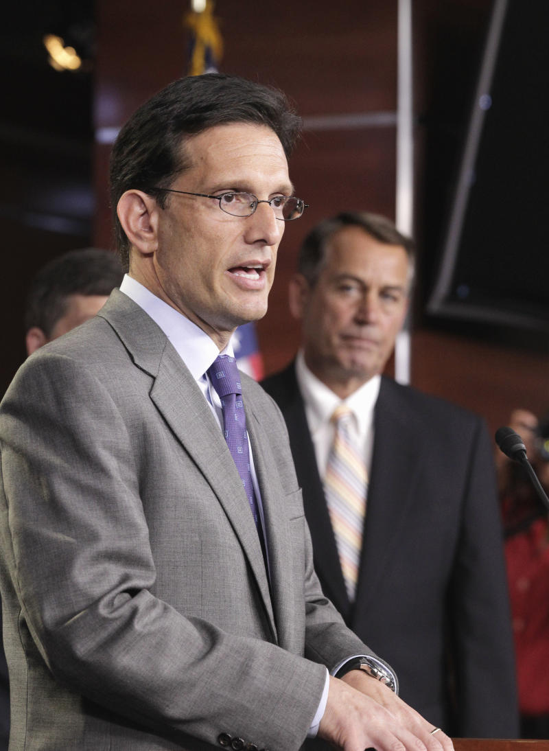 House Majority Leader Eric Cantor of Va., left, accompanied by House Speaker John Boehner of Ohio, right, speaks during a news conference on Capitol Hill in Washington, Tuesday, July 19, 2011, to discuss the debt limit crisis.  (AP Photo/J. Scott Applewhite)