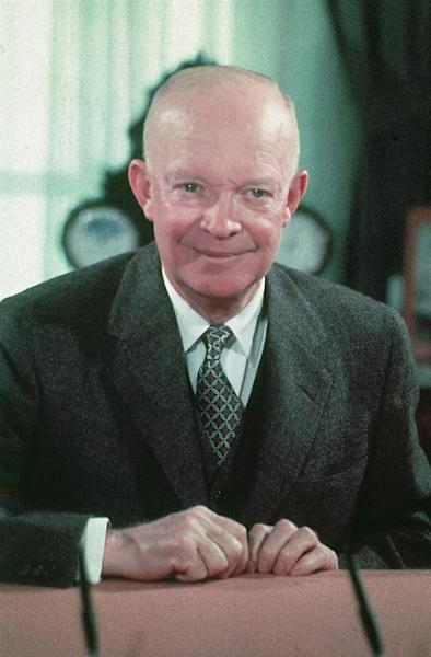 FILE - In this 1956 file photo, President Dwight Eisenhower is seen at his desk at the White House in Washington. The future of a planned memorial honoring President Dwight D. Eisenhower was thrown into doubt Tuesday as lawmakers questioned the project's design and cost and Ike's family called again for the memorial project to be redesigned. A House panel hosted a hearing on the 14-year-old project, which has secured a site for the memorial at the foot of Capitol Hill near the National Air and Space Museum. Planners could lose that space, though, without an extension soon from Congress. (AP Photo, File)