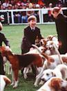 <p>The royals are known for their love of animals, particularly dogs, with Prince William showing the same fondness at Badminton Horse Trials in 1991. (Anwar Hussein)</p>