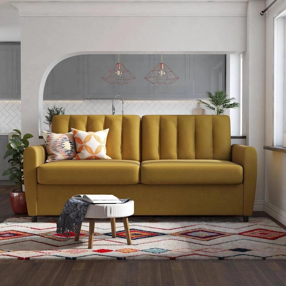 <p>Add some color to your space with the <span>Novogratz Brittany Sleeper Sofa With Memory Foam Mattress</span> ($1,000).</p>