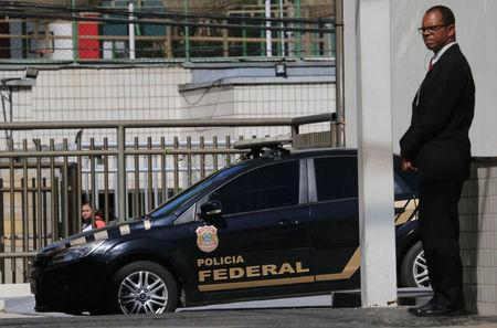 A Federal Police car is seen next to the headquarter of the Brazilian Olympic Committee in Rio de Janeiro, Brazil September 5, 2017. REUTERS/Sergio Moraes