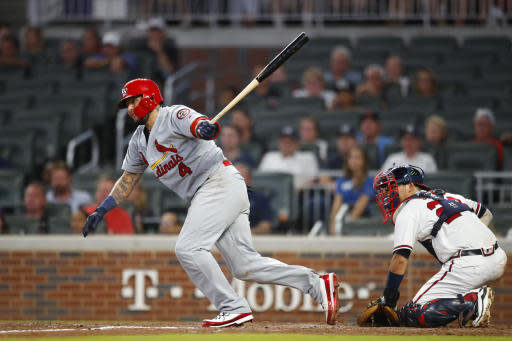 St. Louis Cardinals' Yadier Molina (4) watches his single during the eighth inning of a baseball game against the Atlanta Braves, Tuesday, Sept. 18, 2018, in Atlanta. Three runs scored on the hit and an error by Braves' Ronald Acuna Jr. (AP Photo/Todd Kirkland)
