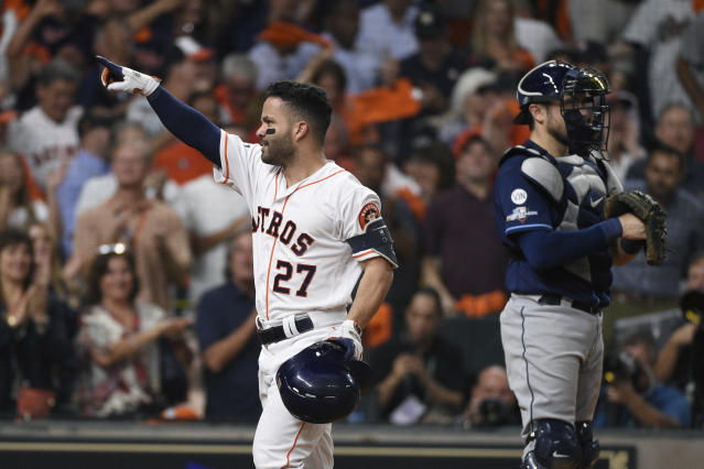 Houston Astros' Jose Altuve (27) celebrates his solo home run against the Tampa Bay Rays during the eighth inning of Game 5 of a baseball American League Division Series in Houston, Thursday, Oct. 10, 2019. (AP Photo/Eric Christian Smith)