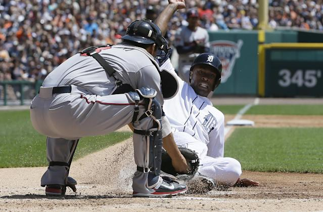 Minnesota Twins catcher Kurt Suzuki applies the tag on Detroit Tigers' Austin Jackson at home during the second inning of a baseball game in Detroit, Saturday, May 10, 2014. (AP Photo/Carlos Osorio)