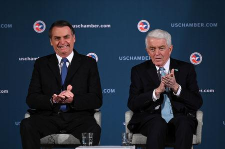 Brazilian President Jair Bolsonaro and CEO of the United States Chamber of Commerce Tom Donohue participate in a Brazil-U.S. Business Council forum to discuss relations and future cooperation and engagement in Washington, U.S. March 18, 2019. REUTERS/Erin Scott