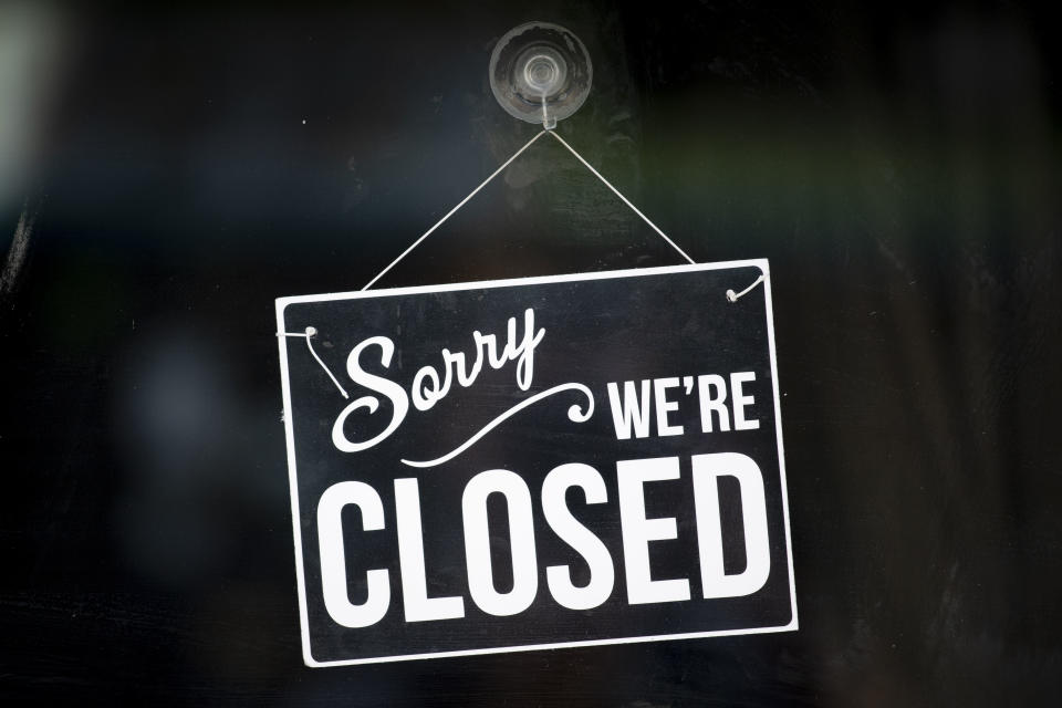 A closed sign in the window of a small business on May 19, 2020 in Cardiff, United Kingdom.