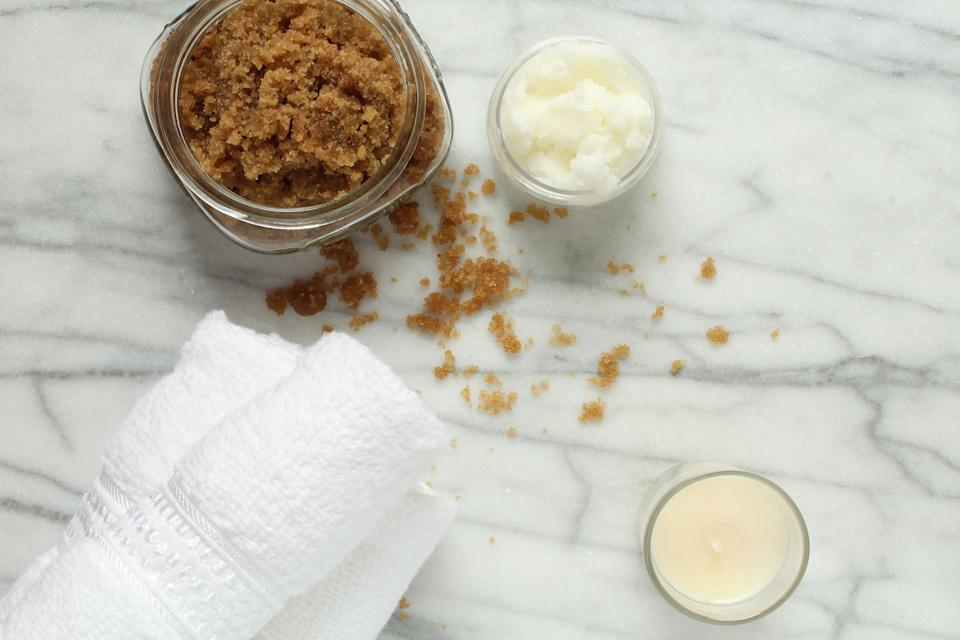 Above view of homemade brown sugar scrub and ingredients. Copy space.