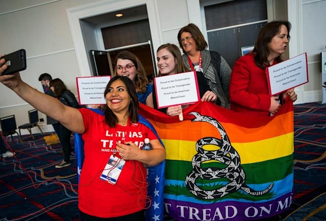 <p>Teresa Mendoza (L) takes a selfie with transgender attendees to the 45th annual Conservative Political Action Conference (CPAC) at the Gaylord National Resort & Convention Center in National Harbor, Md., Feb. 23 2018. (Photo: Jim Lo Scalzo/EPA-EFE/REX/Shutterstock) </p>