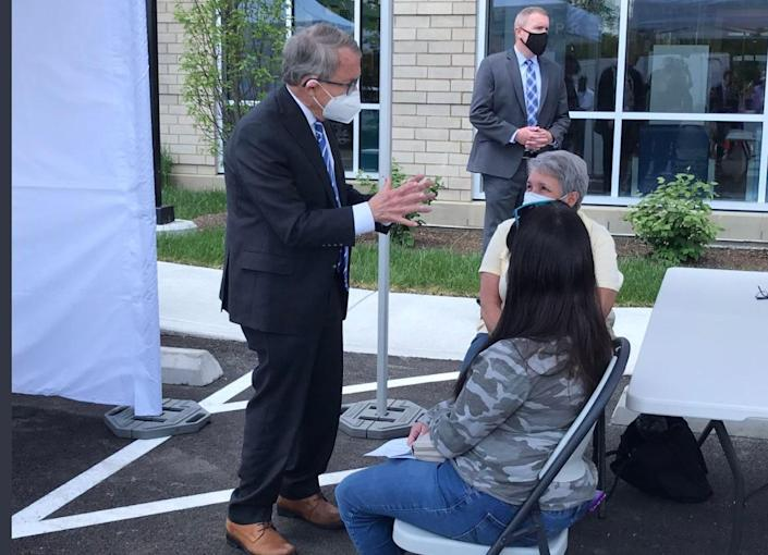 Ohio Gov. Mike DeWine is touring a mobile vaccine clinic at a library in The East Price Hill neighborhood of Cincinnati.