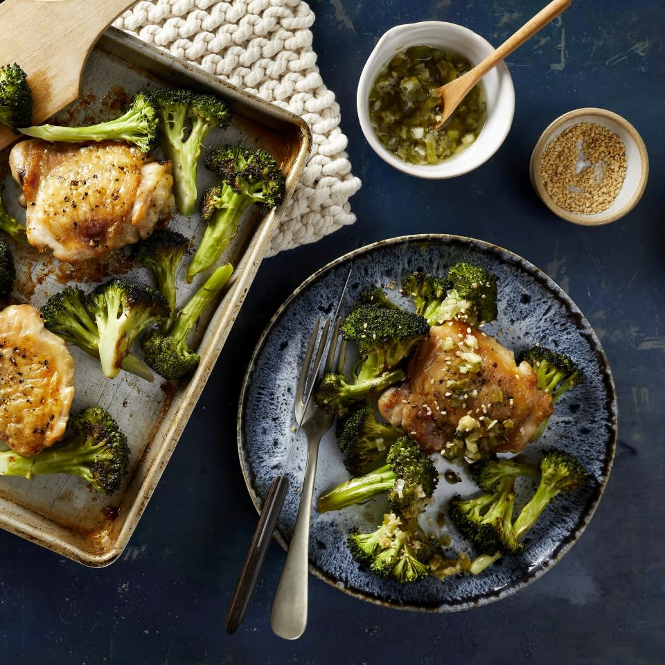 """<p>In this healthy sheet-pan chicken recipe, meaty bone-in chicken thighs and broccoli florets are tossed with sesame oil and roasted on the same pan for a delicious and easy dinner with minimal cleanup. While the chicken and broccoli cook, whip together the simple scallion-ginger sauce. The sauce would also be wonderful spooned over salmon, tofu or grain bowls; it is easily doubled or tripled! <a href=""""http://www.eatingwell.com/recipe/272931/sheet-pan-sesame-chicken-broccoli-with-scallion-ginger-sauce/"""" rel=""""nofollow noopener"""" target=""""_blank"""" data-ylk=""""slk:View recipe"""" class=""""link rapid-noclick-resp""""> View recipe </a></p>"""