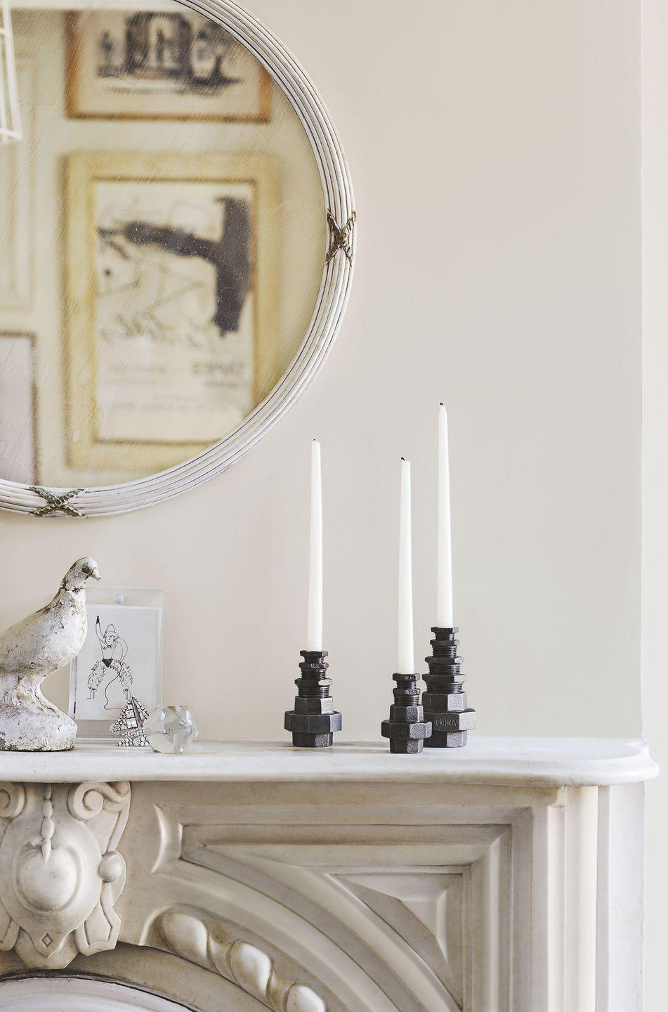 <p>You can never go wrong with candlesticks on a mantel—a no-fuss way to bring warmth into your space. </p>