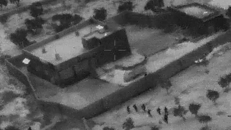 This image from video released by the Department of Defense on Wednesday, Oct. 30, 2019, and displayed at a Pentagon briefing, shows U.S. Special Forces, figures at lower right, moving toward compound of Islamic State leader Abu Bakr al-Baghdadi on Saturday, Oct. 26, 2019. (Photo: Department of Defense via AP)