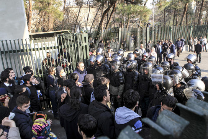 <p>In this photo taken by an individual not employed by the Associated Press and obtained by the AP outside Iran, anti-riot Iranian police prevent university students to join other protesters over Iran weak economy, in Tehran, Iran, Saturday, Dec. 30, 2017. (Photo: AP) </p>