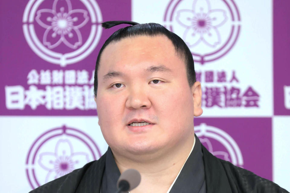 Hakuho speaks at a press conference to announce his retirement at Ryogoku Kokugikan Stadium in Tokyo Friday, Oct. 1, 2021. Mongolia-born Hakuho was famous for his diligent training that led him to be the sumo grand champion, or Yokozuna, with victories in a record-45 tournaments. (Kyodo News via AP)