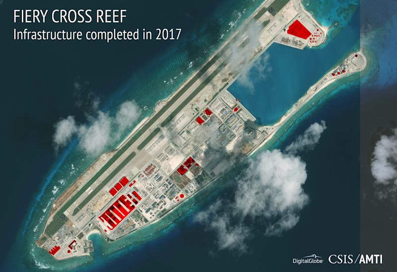 This image provided by CSIS Asia Maritime Transparency Initiative/DigitalGlobe shows a satellite image of Fiery Cross Reef in Spratly island chain in the South China Sea, annotated by the source to show areas where China has conducted construction work above ground during 2017. Tensions have eased in the disputed region in the past year, but the Washington-based Asia Maritime Transparency Initiative says China has been busy, building infrastructure to equip outposts to be air and naval bases. Tensions over China's island-building in the South China Sea may have eased in the past year, but Beijing has kept busy. New satellite imagery shows China has built infrastructure covering 72 acres in the Spratly and Paracel islands during 2017 to equip its larger outposts to be air and naval bases.(CSIS Asia Maritime Transparency Initiative/DigitalGlobe via AP)