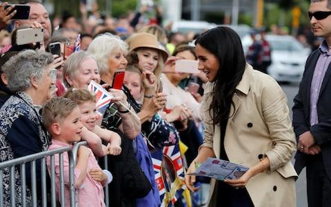 The Duchess of Sussex speaks to members of the public as she arrives at the Royal Botanic Gardens in Melbourne - Credit: Phil Noble/Getty