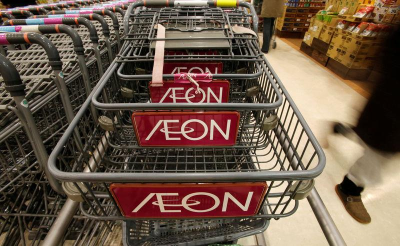 FILE PHOTO: Logo of Aeon Co is seen on shopping carts at its supermarket in Tokyo