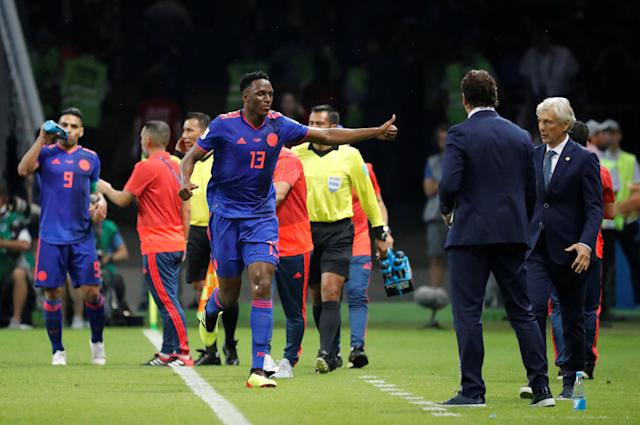 Soccer Football - World Cup - Group H - Poland vs Colombia - Kazan Arena, Kazan, Russia - June 24, 2018 Colombia's Yerry Mina celebrates scoring their first goal with coach Jose Pekerman REUTERS/Toru Hanai