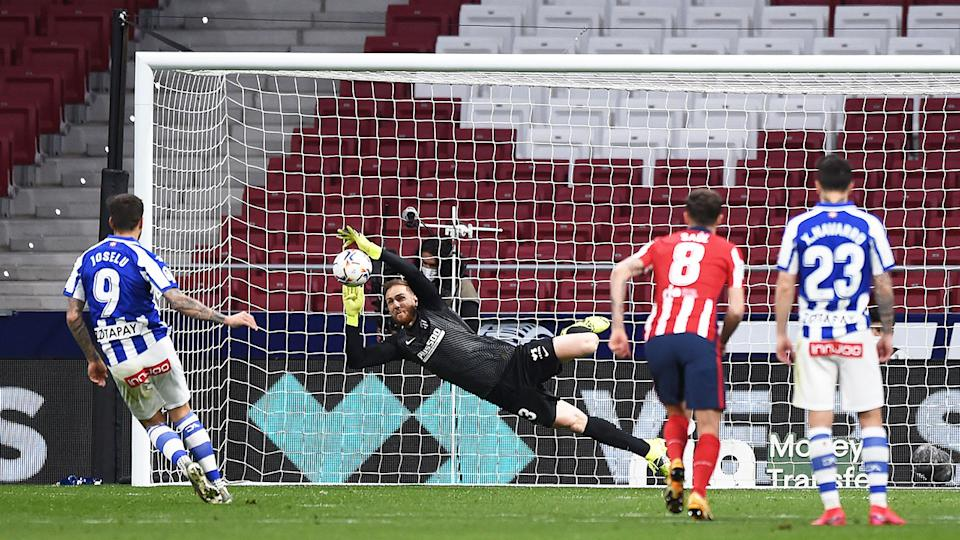Pictured here, Jan Oblak saves a spot-kick for Atletico Madrid against Alaves.