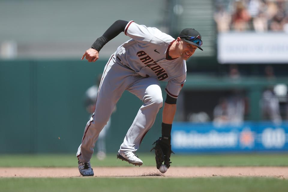 SAN FRANCISCO, CALIFORNIA - JUNE 17: Nick Ahmed #13 of the Arizona Diamondbacks is unable to field the ball in an attempt to flick it to first base for an out in the bottom of the fifth inning against the San Francisco Giants at Oracle Park on June 17, 2021 in San Francisco, California. (Photo by Lachlan Cunningham/Getty Images)