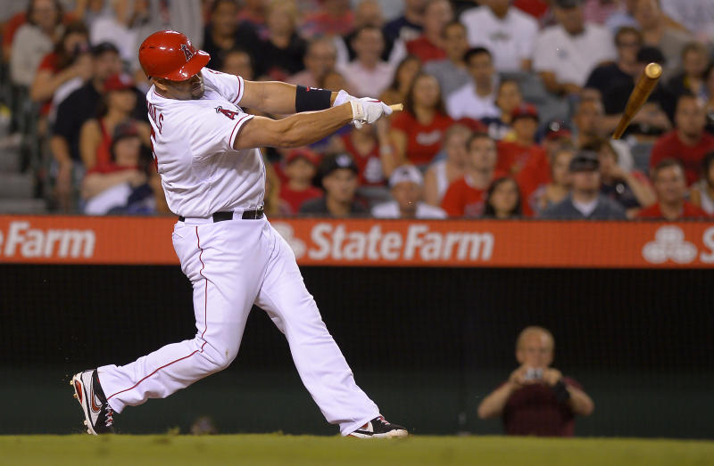 Los Angeles Angels' Albert Pujols breaks his bat as he grounds out during the seventh inning of their baseball game against the St. Louis Cardinals, Tuesday, July 2, 2013, in Anaheim, Calif. (AP Photo/Mark J. Terrill)