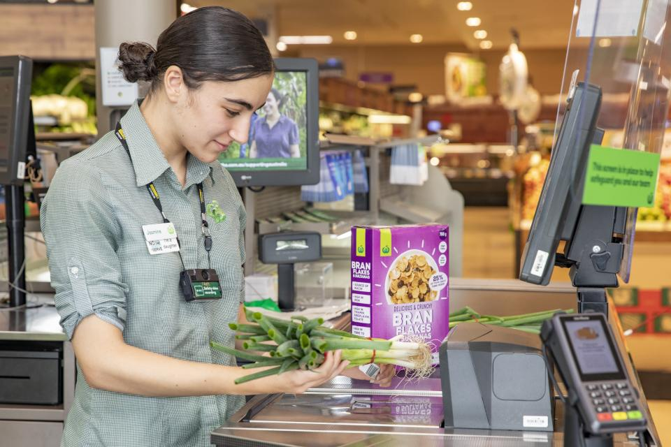 Woolworths staff member Jasmine Sakoua is pictured wearing a body camera at the Rosehill store.
