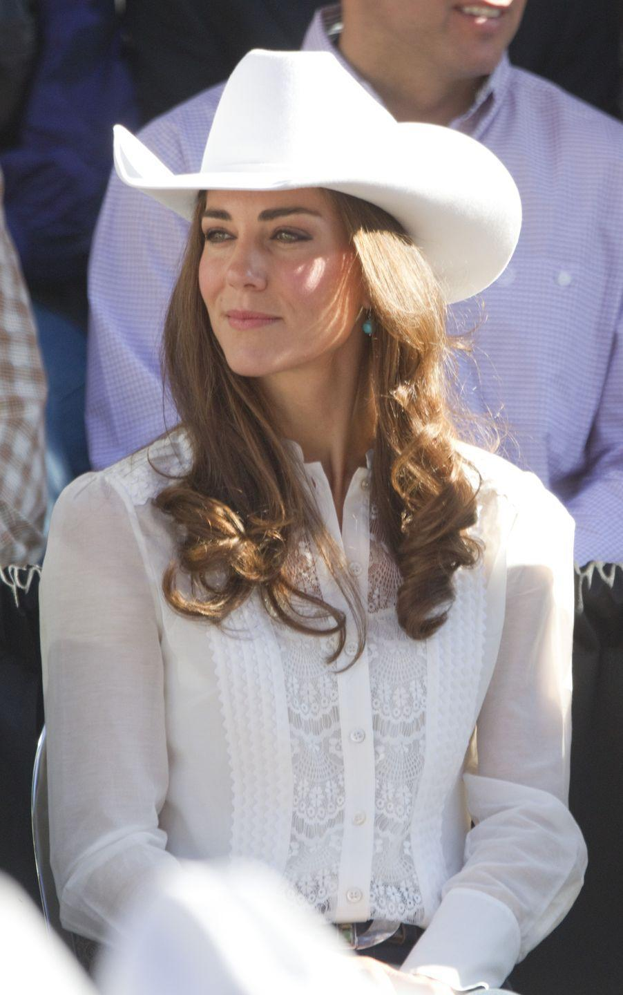 """<p>Shortly after her <a href=""""https://www.townandcountrymag.com/the-scene/weddings/g20052313/kate-middleton-prince-william-royal-wedding-2011-photos/"""" rel=""""nofollow noopener"""" target=""""_blank"""" data-ylk=""""slk:fairytale wedding"""" class=""""link rapid-noclick-resp"""">fairytale wedding</a> to Prince William in April 2011, the Duchess of Cambridge embarked on a royal tour of North America with her husband. In Calgary, Canada, she was gifted a pair of turquoise earrings by designer Corrie McLeod, which she then wore to complement her Western-themed ensemble for the Calgary Stampede Parade.<br></p>"""
