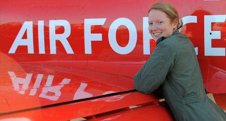 Flight Lieutenant Kirsty Moore, the first woman pilot to join the RAF's Red Arrows display team, stands with her Hawk aircraft at RAF Scampton on November 12, 2009 (AFP Photo/Andrew Yates)