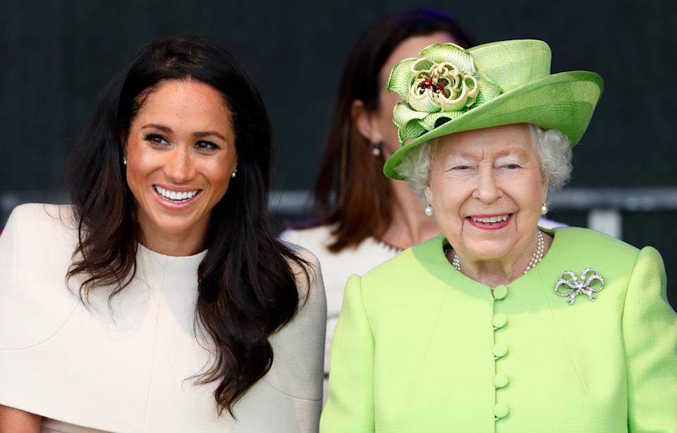 Meghan, Duchess of Sussex and Queen Elizabeth II sit together at a ceremony to open the new Mersey Gateway Bridge on June 14, 2018 in Widnes, England