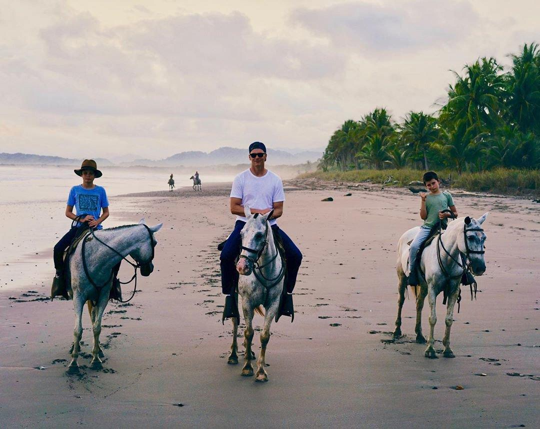 """Brady and his boys may not have taken their horses to the <a href=""""https://people.com/music/lil-nas-x-reacts-old-town-road-longest-running-number-one/"""">""""Old Town Road,""""</a> but they did go for a lovely sunset trot along the beach during their <a href=""""https://www.instagram.com/p/B0D3EE-BD49/"""">summer getaway</a>."""