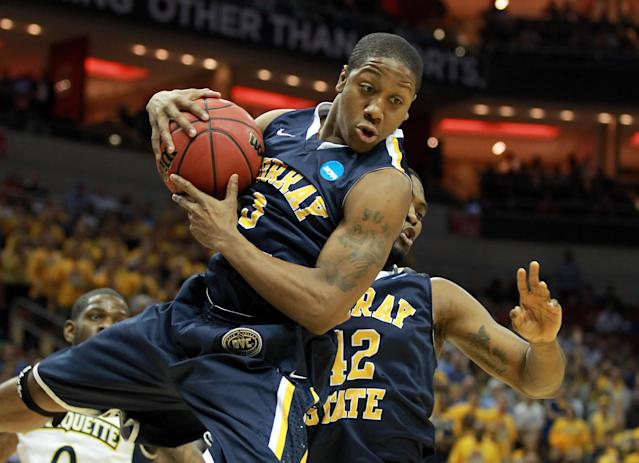 LOUISVILLE, KY - MARCH 17: Isaiah Canaan #3 of the Murray State Racers grabs a rebound in the first half while taking on the Marquette Golden Eagles during the third round of the 2012 NCAA Men's Basketball Tournament at KFC YUM! Center on March 15, 2012 in Louisville, Kentucky. (Photo by Andy Lyons/Getty Images)