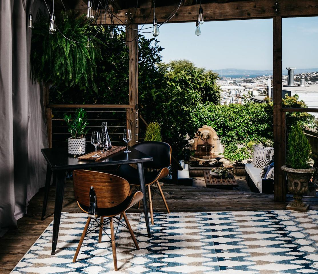 """<p>A covered terrace in San Francisco takes inspiration from the iconic style, with mid-century modern chairs and a summery, patterned rug.</p><p><em>Design by <a href=""""https://deringhall.com/interior-designers/deniece-duscheone-inc"""" target=""""_parent"""">Deniece Duscheone Inc.</a></em></p>"""