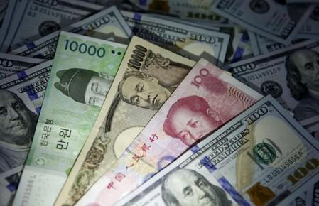 Most Asian currencies rise as dollar slips; trade signals mixed