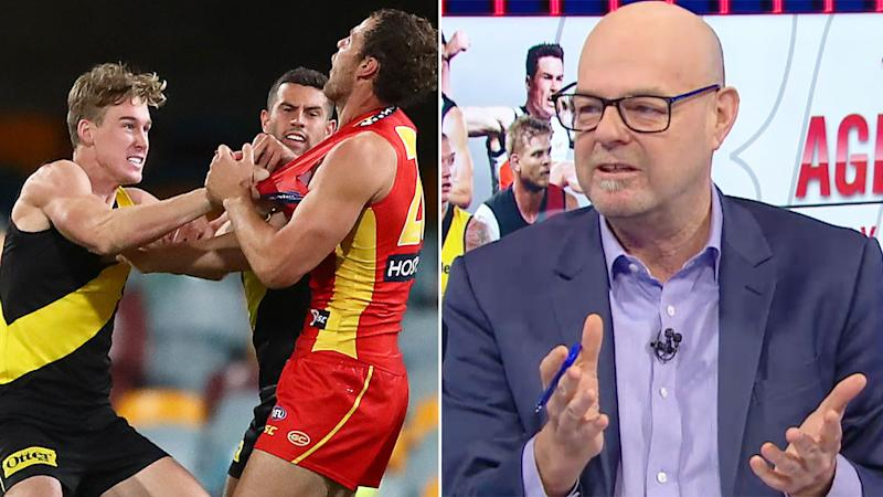 Pictured here, Tom Lynch arguing with Suns players on the left and AFL 360 co-host Mark Robinson on the right.